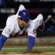 New York Mets' Juan Lagares scores on a hit by Juan Uribe during the sixth inning of Game 3 of the Major League Baseball World Series against the Kansas City Royals Friday, Oct. 30, 2015, in New York. (AP Photo/David J. Phillip)