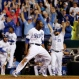Kansas City Royals' Lorenzo Cain celebrates after scoring on a hit by Eric Hosmer against the Toronto Blue Jays during the eight inning in Game 6 of baseball's American League Championship Series on Friday, Oct. 23, 2015, in Kansas City, Mo. (AP Photo/Matt Slocum)