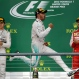Mercedes driver Lewis Hamilton, of Britain, celebrates after winning the world championship win his victory at the Formula One U.S. Grand Prix auto race at the Circuit of the Americas, Sunday, Oct. 25, 2015, in Austin, Texas. Left is Mercedes driver Nico Rosberg, of Germany, and right, Ferrari driver Sebastian Vettel, of Germany. (AP Photo/Darron Cummings)
