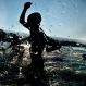 A male competitor exits the water during the swimming portion of the Ironman World Championship Triathlon, Saturday, Oct. 10, 2015, in Kailua-Kona, Hawaii. (AP Photo/Mark J. Terrill)
