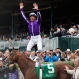 Jockey Lanfranco Dettori jumps off of Pablo Del Monte in the winner's circle after winning the first race of the day at Keeneland race track Friday, Oct. 30, 2015, in Lexington, Ky. The Breeders' Cup horse races begin later on Friday. (AP Photo/Brynn Anderson)
