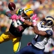 Green Bay Packers' Sam Shields breaks up a pass intended for St. Louis Rams' Tavon Austin during the first half an NFL football game Sunday, Oct. 11, 2015, in Green Bay, Wis. (AP Photo/Matt Ludtke)