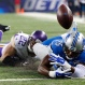 Detroit Lions running back Theo Riddick (25) loses control of the ball at the goal line after being tackled by Minnesota Vikings free safety Harrison Smith (22) during the first half of an NFL football game, Sunday, Oct. 25, 2015, in Detroit. (AP Photo/Rick Osentoski)