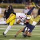 Notre Dame's DeShone Kizer (14) is tackled by Southern California's Marvell Tell III (7) during the second half of an NCAA college football game Saturday, Oct. 17, 2015, in South Bend, Ind. Notre Dame won the game 41-31. (AP Photo/Darron Cummings)