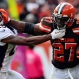 Cleveland Browns running back Robert Turbin (27) stiff-arms Denver Broncos cornerback Chris Harris (25) during the first half of an NFL football game Sunday, Oct. 18, 2015, in Cleveland. (AP Photo/Aaron Josefczyk)