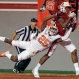 Clemson's Cordrea Tankersley (25) reaches for the ball as North Carolina State's Johnathan Alston hauls in a touchdown pass during the second half of an NCAA college football game in Raleigh, N.C., Saturday, Oct. 31, 2015. Clemson won 56-41. (AP Photo/Gerry Broome)