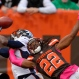 Denver Broncos wide receiver Emmanuel Sanders (10) can't hold onto the ball under pressure from Cleveland Browns defensive back Tramon Williams (22) during the second half of an NFL football game, Sunday, Oct. 18, 2015, in Cleveland. (AP Photo/David Richard)
