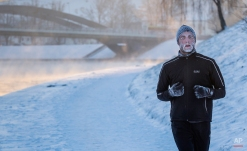 A man with frost on his face runs along the banks of the Neris river as temperatures dipped to -18 degrees Celsius (-0,40 degrees Fahrenheit) in Vilnius, Lithuania, Thursday, Dec. 31, 2015. (AP Photo/Mindaugas Kulbis)