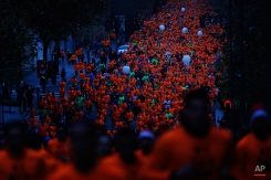 Tens of thousands run during the popular San Silvestre road race in Madrid, Thursday, Dec. 31, 2015. Every year on Dec. 31 since 1964 thousands of amateur and professional runners participate in this 10 kilometres (6.3 miles) urban race along the streets of Madrid. (AP Photo/Francisco Seco)