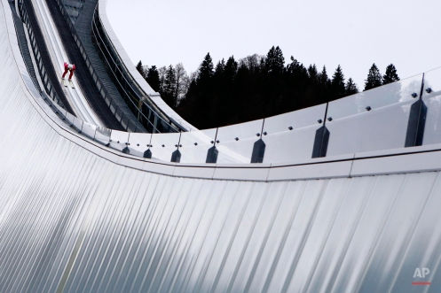 Switzerland's Simon Ammann starts from the hill during his trial jump at the second stage of the 64th four hills ski jumping tournament in Garmisch-Partenkirchen, Germany, Thursday, Dec. 31, 2015. (AP Photo/Matthias Schrader)