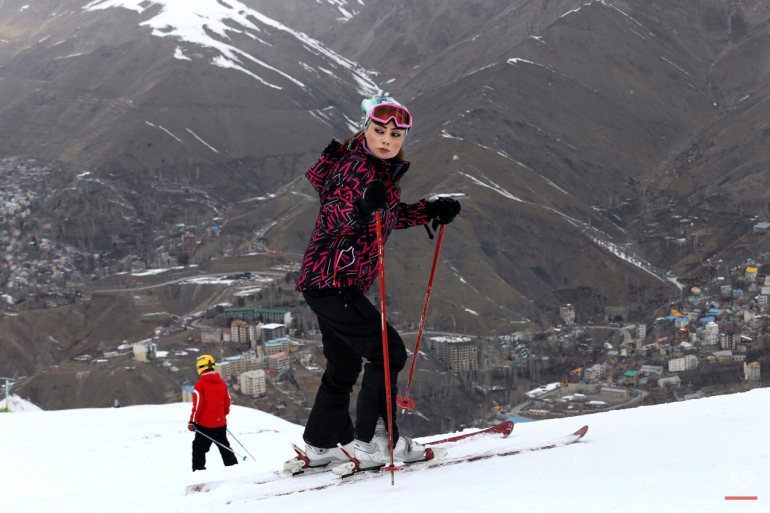 In this Friday, Jan. 16, 2015 photo, Iranian skier Zahra Jabbari stands prior to her descent from a slope at the Shemshak ski resort in the Alborz mountain range 36 miles (60 kilometers) northeast of the capital Tehran, Iran. (AP Photo/Vahid Salemi)