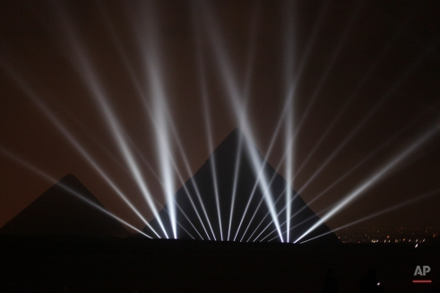 The Great Pyramids are illuminated for New Year's Eve in Giza, near Cairo, Egypt late Thursday, Dec. 31, 2015. (AP Photo/Maya Alleruzzo)