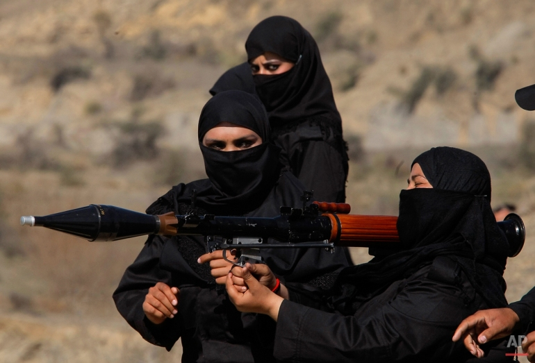 In this Wednesday, Feb. 11, 2015 photo, Pakistani female police commandos attend a training session in Nowshera, near Peshawar Pakistan. Authorities formed a Special Combat Unit after Taliban militants stormed a Peshawar school on Dec. 16, 2014 and massacred 150 children and teachers. (AP Photo/Mohammad Sajjad)
