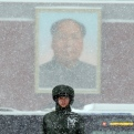 A Chinese paramilitary policeman stands on duty as heavy snow falls near a portrait of late Chinese leader Mao Zedong on Tiananmen Gate in Beijing, Sunday, Nov. 22, 2015. China's meteorological authority forecasted heavy snow and snowstorm in northern China over the weekend. (AP Photo/Ng Han Guan)