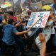 In this Thursday, Nov. 19, 2015, photo, police fire water cannons at student activists as they clash near the venue hosting the Asia-Pacific Economic Cooperation (APEC) summit in Manila, Philippines. Asia-Pacific leaders called Thursday for increased international cooperation in the fight against terrorism as they held annual talks overshadowed by the Paris attacks. (AP Photo/Wally Santana)