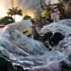 Water splashes out of the bucket of a Filipino resident as they help firemen in battling the blaze at a residential area in Mandaluyong, east of Manila, Philippines on Wednesday, Nov. 25, 2015. Mandaluyong City Fire Marshall Nahum Tarroza said about 1,000 homes were burned during the fire. The cause of the fire is still being investigated. (AP Photo/Aaron Favila)