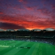 Lights illuminate the Adelaide Oval as the sun sets during the first night session of the cricket test between Australia and New Zealand in Adelaide, Friday, Nov. 27, 2015. This match is the sport's first ever day-night test and the use of the 'experimental' pink leather ball replacing the standard-issue red for the first time in a format that dates back to the 1870s. (AP Photo/Rick Rycroft)
