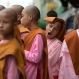 In this Tuesday, Nov. 10, 2015 photo, novice Buddhist nuns line up after walking the streets to collect alms in central Yangon, Myanmar. (AP Photo/Mark Baker)