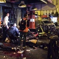 Victims of a shooting attack lay on the pavement outside La Belle Equipe restaurant in Paris Friday, Nov. 13, 2015. Well over 100 people were killed in Paris on Friday night in a series of shooting, explosions. (Anne Sophie Chaisemartin via AP)