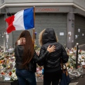 Two women stand outside the Petit Cambodge restaurant, a site of last Friday's attacks, in Paris, Tuesday, Nov. 17, 2015. France made an unprecedented demand on Tuesday for its European Union allies to support its military action against the Islamic State group as it launched new airstrikes on the militants' Syrian stronghold, days after attacks in Paris linked to the group killed at least 129 people. (AP Photo/Daniel Ochoa de Olza)