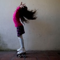 """In this Sept. 29, 2015 photo, Luana poses for photos on her roller skates at her home in Merlo, Argentina. Luana says that when one of the girls asked her why she had a penis, a friend jumped in. """"She's transsexual,"""" the child explained, nonchalantly. That level of comfort is no doubt in part because Luana herself appears so at ease. In 2013, she became the youngest person to take advantage of a progressive Argentine law that allows people to identify their own gender for legal purposes. (AP Photo/Natacha Pisarenko)"""
