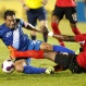 Guatemala's Carlos Ruiz, left, and Trinidad and Tobago's Sheldon Bateau fight for the ball during a 2018 World Cup qualifying soccer match in Guatemala City, Friday, Nov. 13, 2015. Trinidad and Tobago won 2-1. (AP Photo/Moises Castillo)