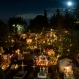 Candles illuminate children's tombs in the San Gregorio cemetery during Day of the Dead festivities on the outskirts of Mexico City, late Saturday, Nov. 1, 2015. In a tradition that coincides with All Saints Day and All Souls Day on Nov. 1 and 2, families decorate the graves of departed relatives with marigolds and candles, and spend the night in the cemetery, eating and drinking as they keep company with their deceased loved ones. At this cemetery, families pay a special tribute to children who have died, on the night of Oct. 31 into the morning of Nov. 1. The following night, families keep vigil at the tombs of adults. (AP Photo/Esteban Felix)