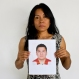 In this May 13, 2015 photo, Adriana Bahena Cruz holds up a photo of her husband, Saulo Rodriguez Cruz, in Iguala, Mexico. Bahena's husband was a detective with the state prosecutor's office in Iguala. On Jan. 7, 2011, he was in downtown Iguala with his wife and children when he received a call saying there was a development in one of his cases and he needed to come into the office. His wife awoke at 2 a.m. to find he was still not home. When she called him he answered, but she heard the voices of a lot of other men in the background. He said he would be home soon. She never heard from him again. (AP Photo/Dario Lopez-Mills)