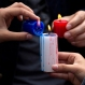 People mix the wax of candles with the French colors outside the French embassy in Lima, Peru, during a ceremony in homage to the victims of the deadly attacks in Paris, Sunday, Nov. 15, 2015. Multiple terrorist attacks across Paris on Friday night left more than one hundred dead and many more injured. (AP Photo/Rodrigo Abd)