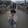 An Arab boy scout plays music during a procession parade to St. George church during a feast to commemorate the bringing of the remains of the great martyr St. George to Lod, Israel, Monday, Nov. 16, 2015. Jerusalem's Greek Patriarch believes the church contains the tomb of St. George. (AP Photo/Ariel Schalit)