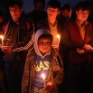 Hazara tribesmen and a teenager hold candles during a ceremony for beheaded Hazara victims, in Kabul, Afghanistan, Tuesday, Nov. 10, 2015. (AP Photos/Massoud Hossaini)