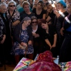 Relatives and friends mourn during the funeral of Israeli Reuven Aviram, 51, In the central Israeli town of Ramla, Friday, Nov. 20, 2015. On Thursday, a Palestinian man stabbed Israelis praying at a makeshift chapel in an office building in southern Tel Aviv, killing two, Reuven Aviram, 51, and Aharon Yesayev, 32, and injuring one moderately. (AP Photo/Oded Balilty)