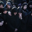 Relatives and friends of Hezbollah member Adel Termos, who was killed in Thursday's twin suicide bombings, mourn during his funeral procession in the southern Lebanese village of Tallousa, Lebanon, Friday, Nov. 13, 2015. Schools and universities across Lebanon are shut down as the country mourns the victims of twin suicide bombings that struck a crowded neighborhood south of the capital. (AP Photo/Mohammed Zaatari)