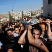 Palestinian mourners carry the body of 22-year-old, Raed Jaradat, during his funeral in the West Bank village of Sa'ir, near Hebron, Sunday, Nov 1, 2015. According to the Israeli army, Jaradat stabbed an Israeli before being shot and killed. (AP Photo/Nasser Shiyoukhi)