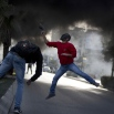 A Palestinian protester uses a sling shot to hurl stones at Israeli troops during clashes, in the West Bank city of Ramallah, Friday, Nov. 20, 2015. (AP Photo/Majdi Mohammed)