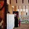 An Egyptian woman looks for her name on a polling list before casting her vote, outside a polling station during the second phase of parliamentary elections, in Qalyoubiya governorate, north of Cairo, Sunday, Nov. 22, 2015. (AP Photo/Nariman El-Mofty)