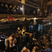 People gather near the site of a twin suicide attack in Burj al-Barajneh, southern Beirut, Thursday, Nov. 12, 2015 that struck a Shiite suburb killed and wounded dozens, according to a Lebanese official. (AP Photo/Bilal Hussein)