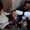 A boy receives a polio vaccination during a house-to-house polio immunization campaign in Sanaa, Yemen. Monday, Nov. 9, 2015. A national three-day anti-Polio immunization campaign to vaccinate more than 5 million children across Yemen began on Monday. (AP Photo/Hani Mohammed)