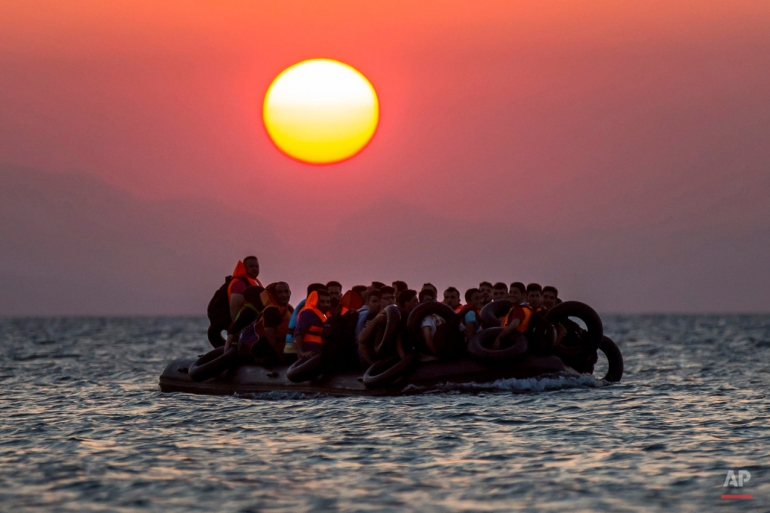 Migrants on a dinghy arrives at the southeastern island of Kos, Greece, after crossing from Turkey, Thursday, Aug. 13, 2015. Greece has become the main gateway to Europe for tens of thousands of refugees and economic migrants, mainly Syrians fleeing war, as fighting in Libya has made the alternative route from north Africa to Italy increasingly dangerous. (AP Photo/Alexander Zemlianichenko)