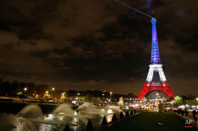 "The illuminated Eiffel Tower shines in the bright colors of the French national flag, the ""Tricolor,"" in Paris, France, Nov. 16, 2015.  130 people were killed in a series of terrorist attacks in Paris on the night Nov. 13, 2015. (Malte Christians/picture-alliance/dpa/AP Images via AP)"