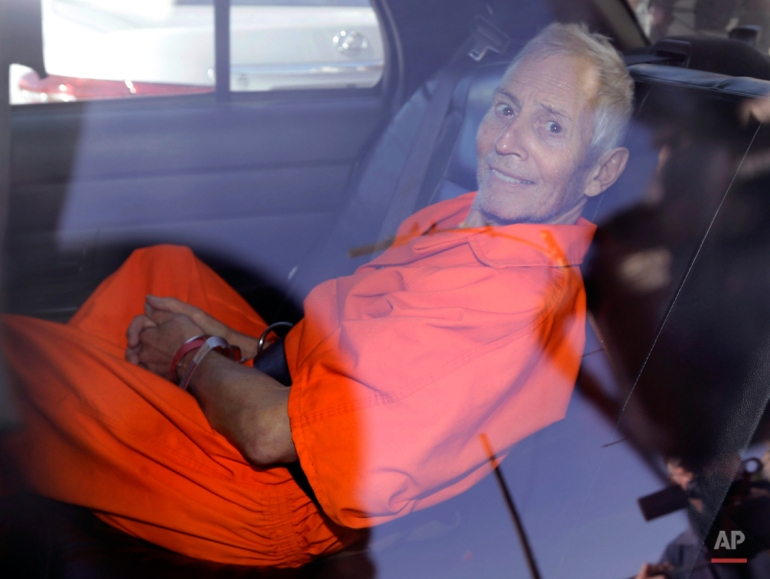 Robert Durst is transported from Orleans Parish Criminal District Court to the Orleans Parish Prison after his arraignment on murder charges in New Orleans, Tuesday, March 17, 2015. (AP Photo/Gerald Herbert)