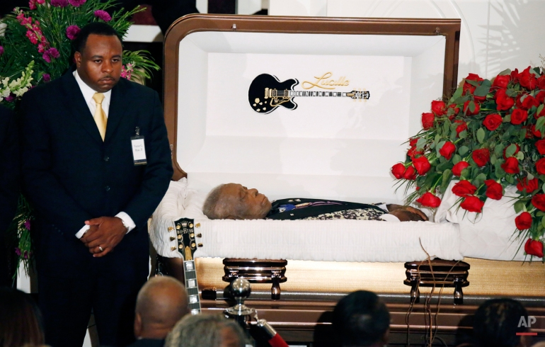 A funeral home attendant stands watch over the casket bearing blues legend B.B. King prior to his funeral mass at Bell Grove Missionary Baptist Church in Indianola, Miss., Saturday, May 30, 2015. (AP Photo/Rogelio V. Solis)