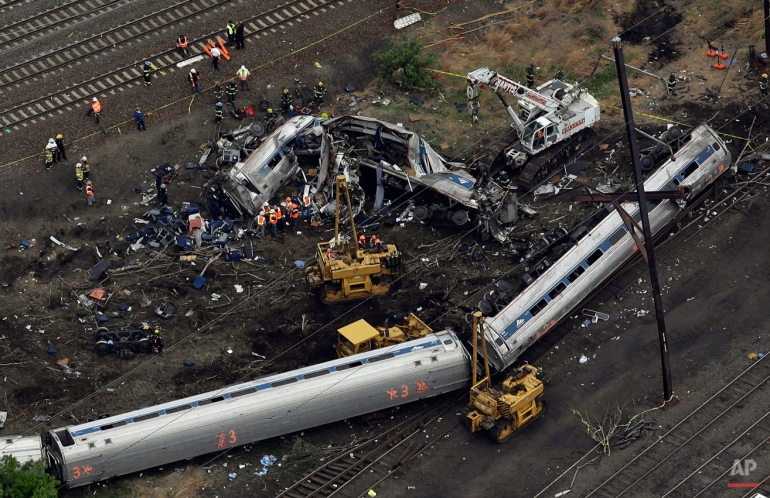 Emergency personnel work at the scene of a deadly train derailment, Wednesday, May 13, 2015, in Philadelphia. The Amtrak train, headed to New York City, derailed and crashed in Philadelphia. (AP Photo/Patrick Semansky)