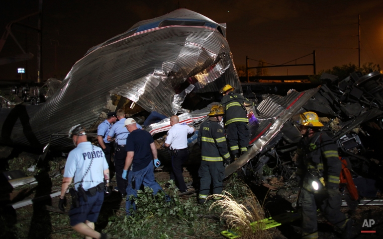 Emergency personnel work at the scene of a deadly train derailment, Wednesday, May 13, 2015, in Philadelphia. The Amtrak train, headed to New York City, derailed and crashed in Philadelphia.  (AP Photo/Joseph Kaczmarek)