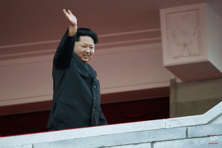 North Korean leader Kim Jong Un waves at a parade in Pyongyang, North Korea, Saturday, Oct. 10, 2015.  Kim declared that his country was ready to stand up to any threat posed by the United States as he spoke at the lavish military parade to mark the 70th anniversary of the North's ruling party and trumpet his third-generation leadership.  (AP Photo/Wong Maye-E)