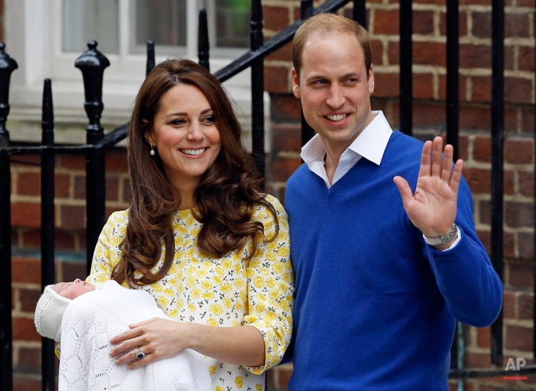 Britain's Prince William and Kate, Duchess of Cambridge and their newborn baby princess, pose for the media as they leave St. Mary's Hospital's exclusive Lindo Wing, London, Saturday, May 2, 2015. (AP Photo/Kirsty Wigglesworth)