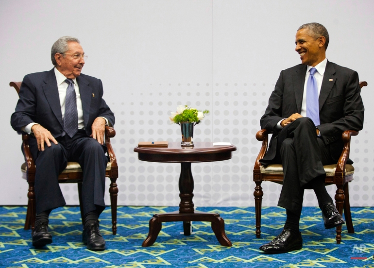 Cuban President Raul Castro, left, and U.S. President Barack Obama meet at the Summit of the Americas in Panama City, Panama, Saturday, April 11, 2015. It was the first formal meeting between the leaders of the two countries in more than half a century, clearing the way for a normalization of relations that had seemed unthinkable to both Cubans and Americans for generations. (AP Photo/Pablo Martinez Monsivais)