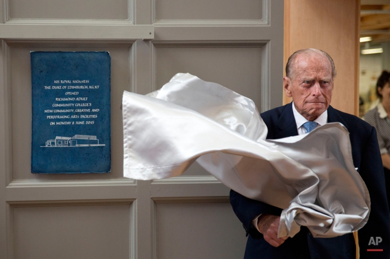 Britain's Prince Philip, the husband of Queen Elizabeth II, unveils a plaque at the end of his visit to Richmond Adult Community College in Richmond, south west London, Monday, June 8, 2015.  The Prince officially opened and was shown around the new art, drama and dance facilities at the further education college which offers up to 2,000 courses.  (AP Photo/Matt Dunham)