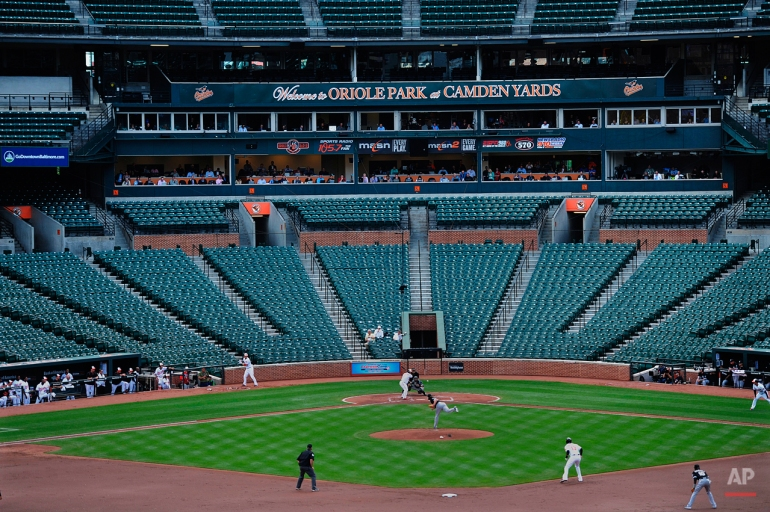 The Baltimore Orioles bat against the Chicago White Sox during a baseball game without fans Wednesday, April 29, 2015, in Baltimore. Due to security concerns in the wake of riots following the funeral for Freddie Gray, the game was closed to the public. Gray suffered a spinal injury in police custody and later died. (AP Photo/Gail Burton)