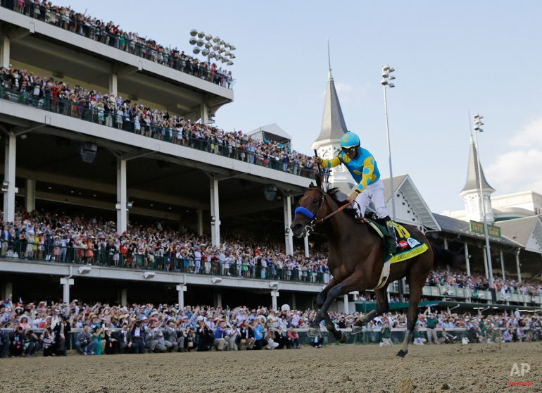 Victor Espinoza rides American Pharoah to victory in the 141st running of the Kentucky Derby horse race at Churchill Downs Saturday, May 2, 2015, in Louisville, Ky. American Pharaoh went on to win the Triple Crown a few weeks later. (AP Photo/David J. Phillip)
